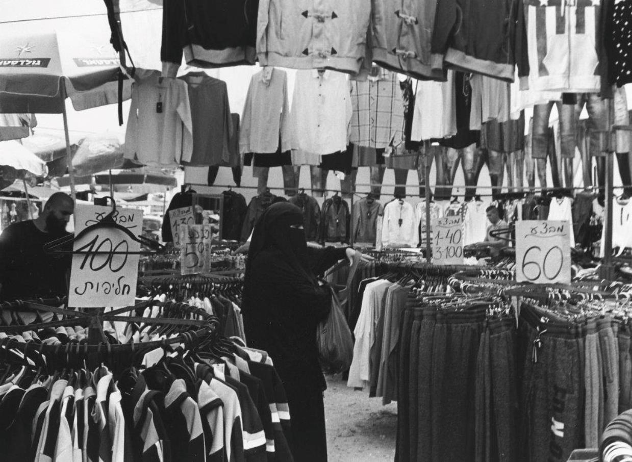 A Muslim woman shopping in Ramla. Photo by Paul Margolis