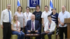 Israeli president Reuven Rivlin hosts medalists from the International Science Olympiads, at the president's residence in Jerusalem on August 21, 2016. Photo by Mark Neyman/GPO