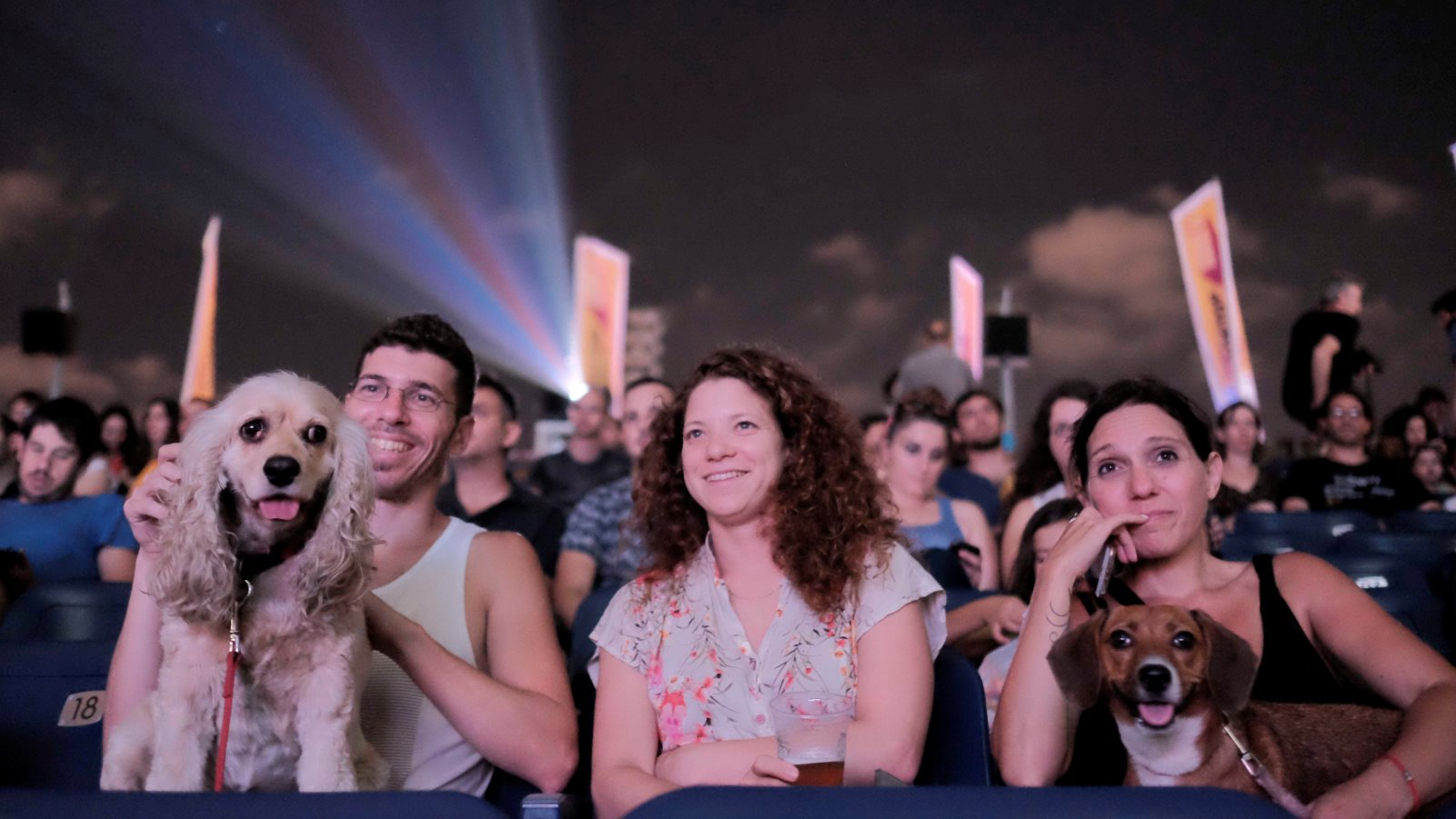 Israelis took their dogs to the movies on a rooftop at the Azrieli Center in Tel-Aviv on July 11, 2016. Photo by Tomer Neuberg/FLASH90