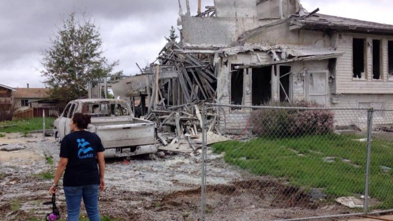 An IsraAID volunteer at the site of a burned home in Fort McMurray. Photo via Facebook