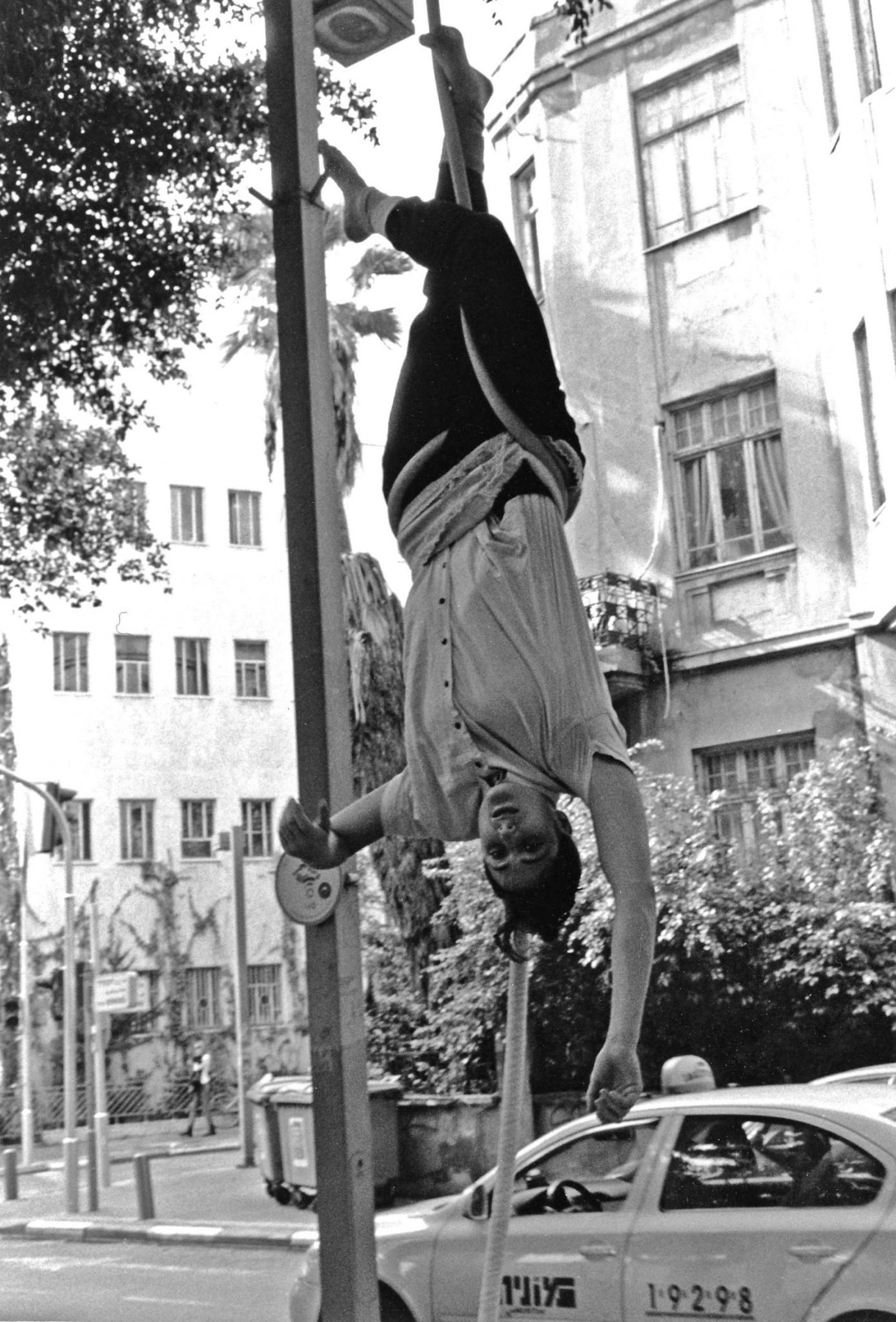 Paul Margolis' photo of aerialist Eli Theodor in Tel Aviv last fall.