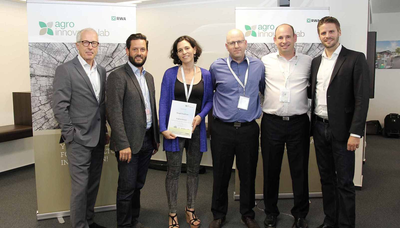 From right, Agro Innovation Lab CEO Reinhard Bauer, Hargol FoodTech CEO Dror Tamir and COO Ben Friedman standing with RWA managers after winning the award. Photo: courtesy