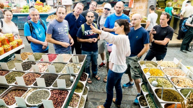 Tali Friedman leading a group around Jerusalem's open marketplace. Photo: courtesy