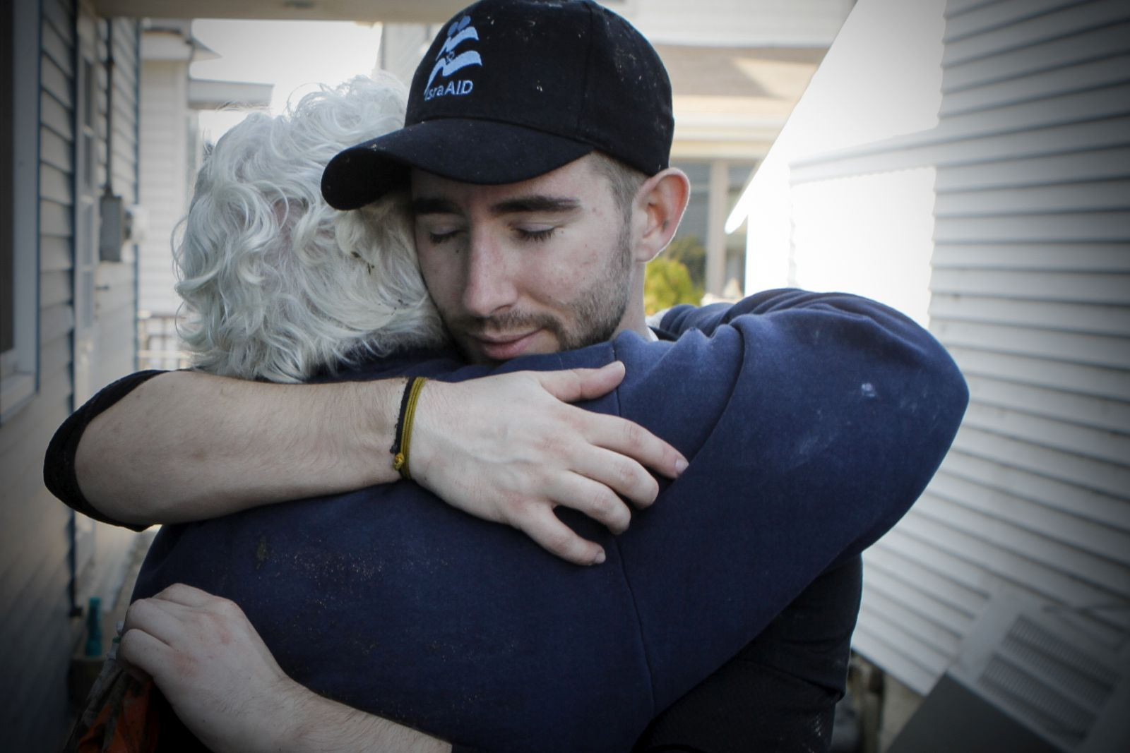 A member of IsraAid offers a supportive hug to a victim of Hurricane Sandy. Photo by Mickey Noam-Alon, IsraAid