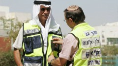 Arab and Jewish ZAKA volunteers in the Negev prepare to rescue victims together. Photo: courtesy