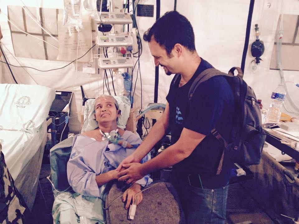 IsraAID's Yotam Polizer visiting Krishna Devi Khadka at the IDF field hospital. Pic courtesy