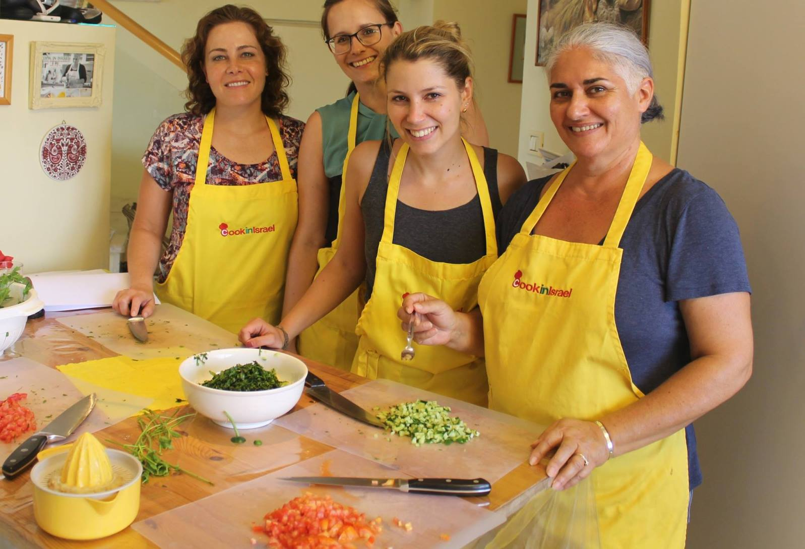 Orly Ziv, right, with guests on her Cook in Israel tour and workshop. Photo via Facebook