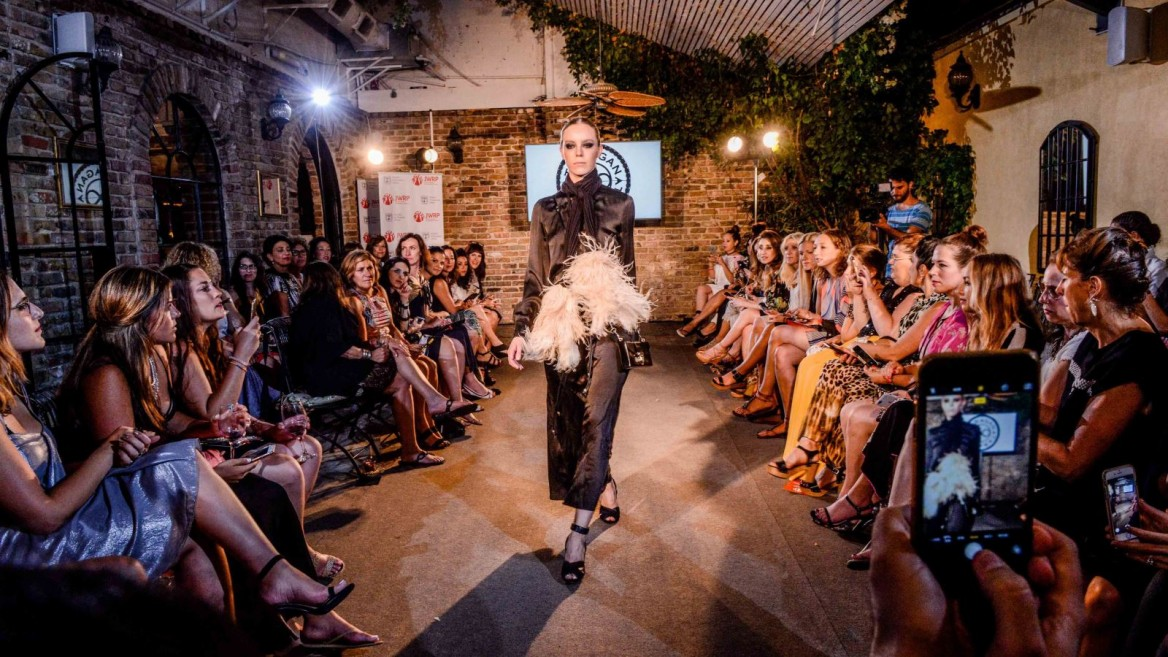 Model Esti Diskin walks the runway wearing an dress by Israeli designer Liora Taragan during the JWRP Fashion Week event in Jaffa. Photo by Aviram Valdman