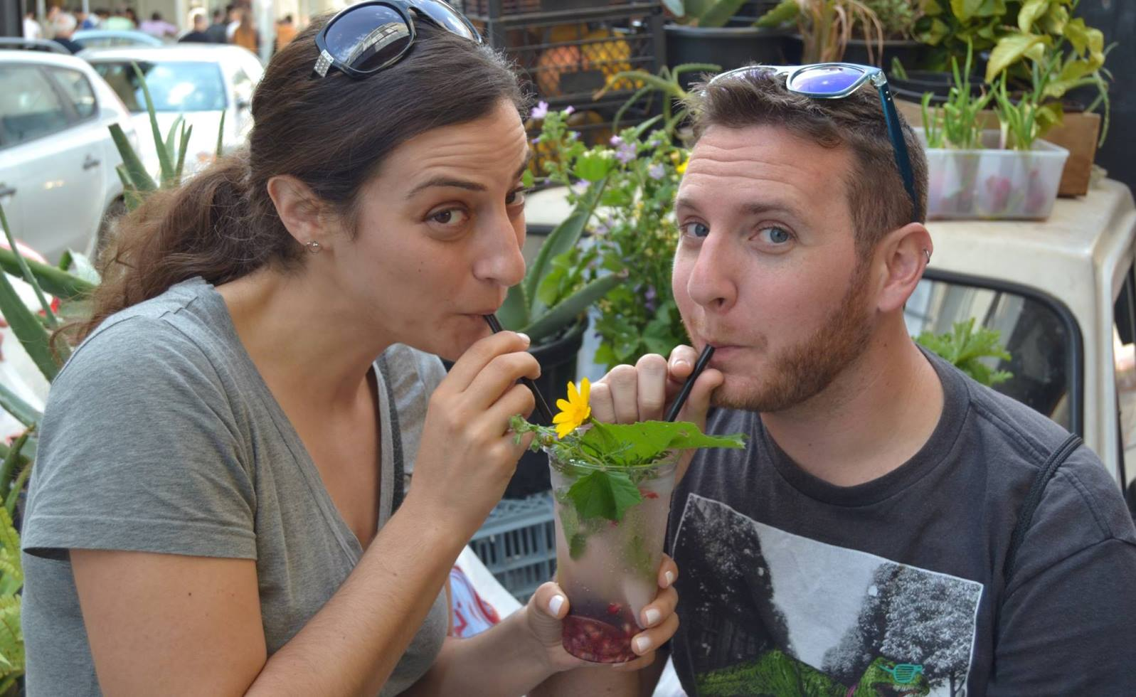 Sarah Cohen and Adam Margolis sipping an original Gazoz on a tour of Florentin. Photo via Aaron Gertz Tours Facebook page