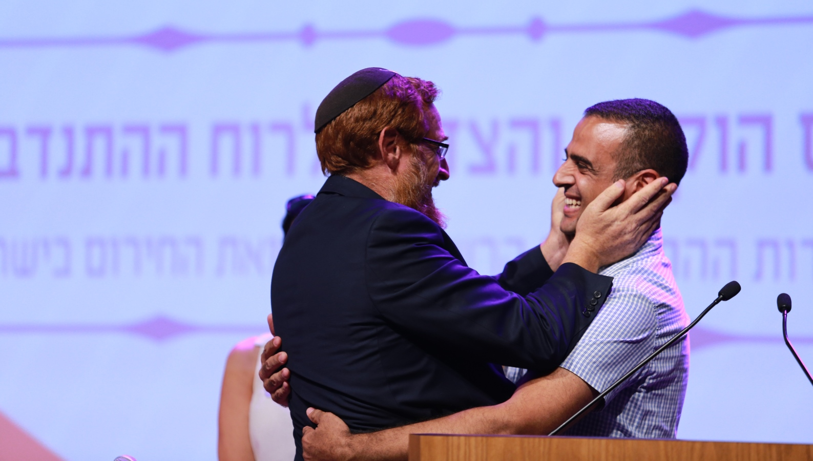 Member of Knesset Yehudah Glick hugging Kabahah Muawhiya, an Arab-Israeli first-responder. Photo by Aharon Crown/United Hatzalah
