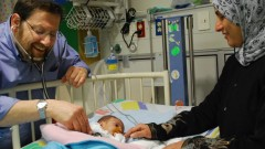 Prof. Azaria JJT Rein, head of pediatric cardiology at Hadassah and cofounder of A Heart for Peace, tending a Palestinian patient. Photo courtesy of A Heart for Peace