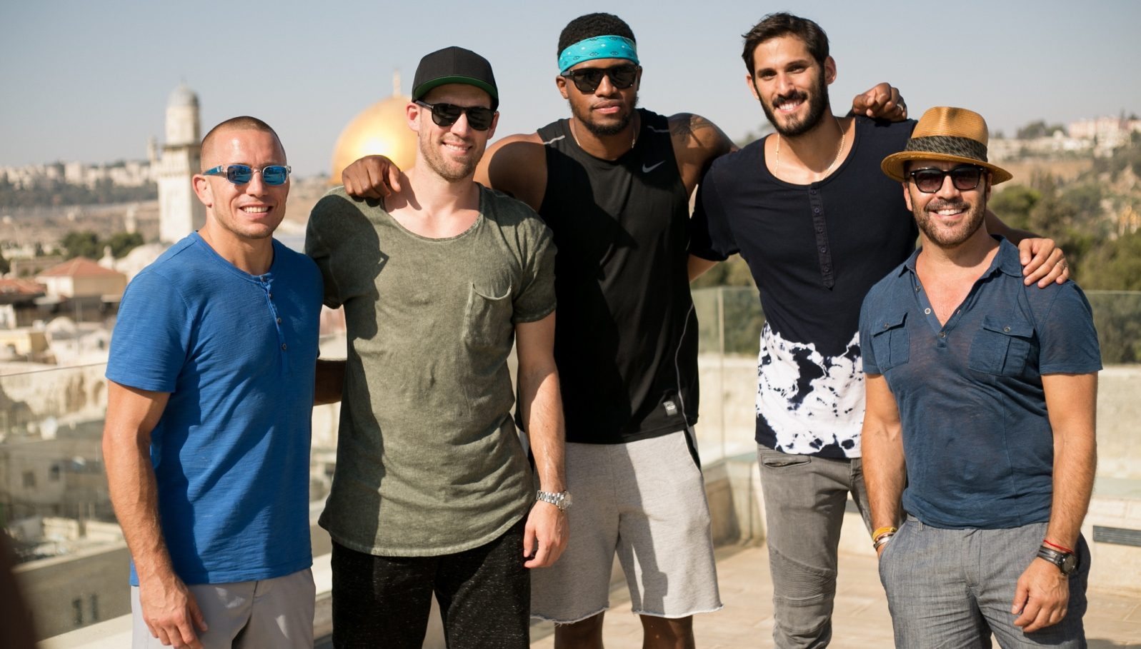 From right, Jeremy Piven, NBA players Omri Casspi, Rudy Gay, Beno Udrih, UFC fighter Georges St-Pierre. Photo by Shir Hassin