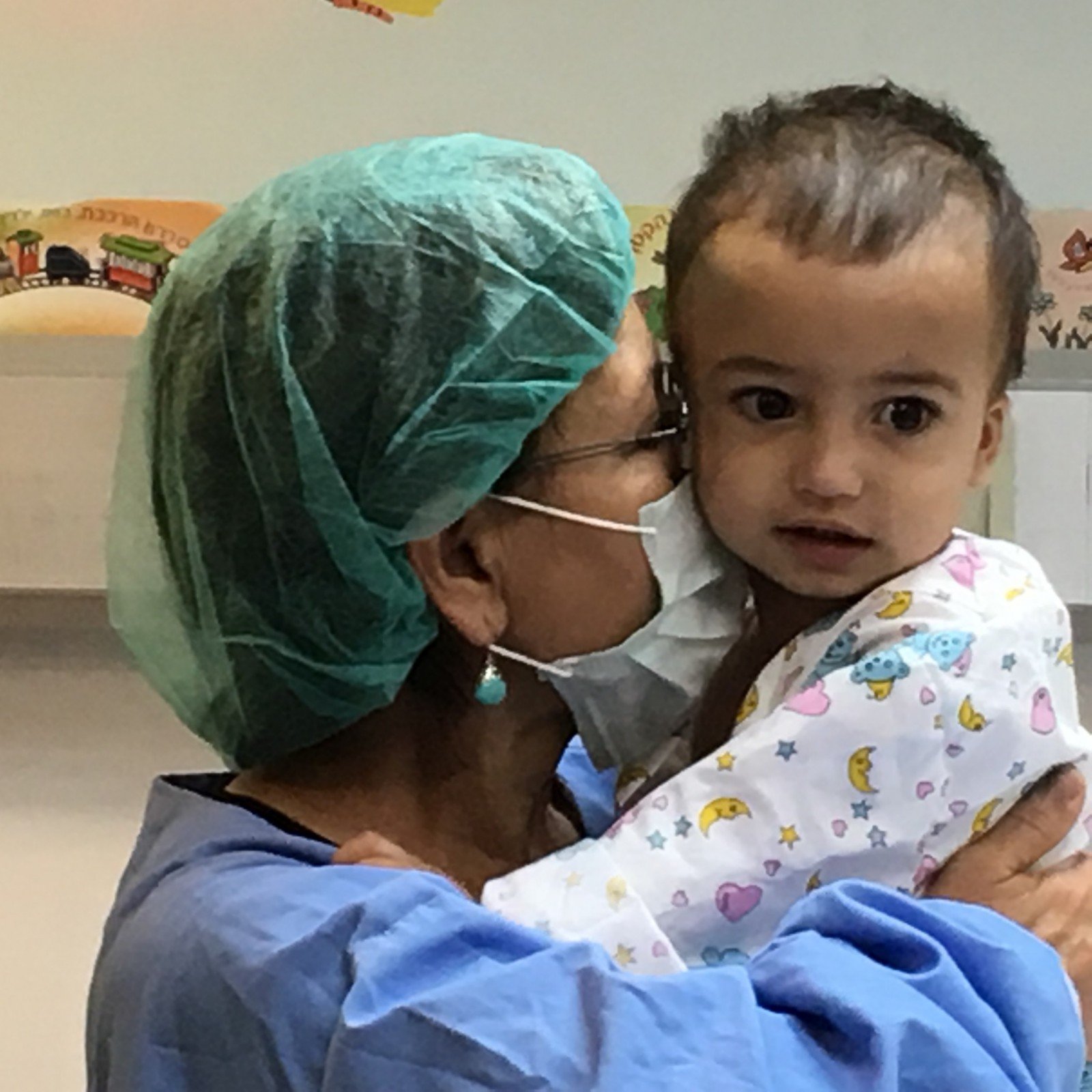 """Fary Moini accompanied Yaya throughout his journey and his surgery. """"I'm just in love with this child,"""" she says. Photo courtesy of SACH"""