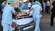 An injured civilian from the civil war in Syria being transferred to Ziv Medical Center in Israel. Photo by Simon Haddad