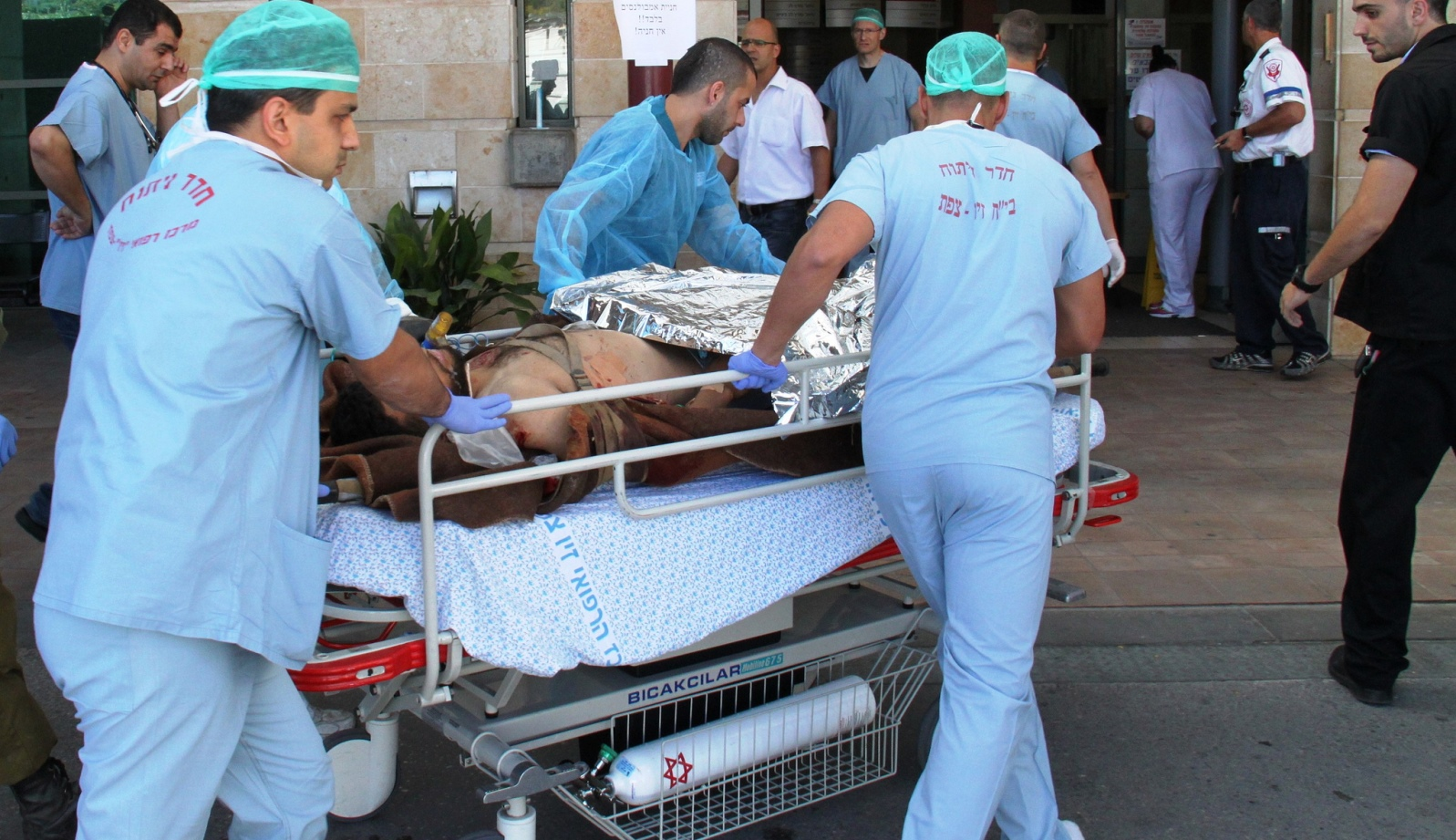 An injured civilian from the civil war in Syria being transferred to Ziv Medical Center in Israel. Photo by Simon Haddad/Ziv Medical Center