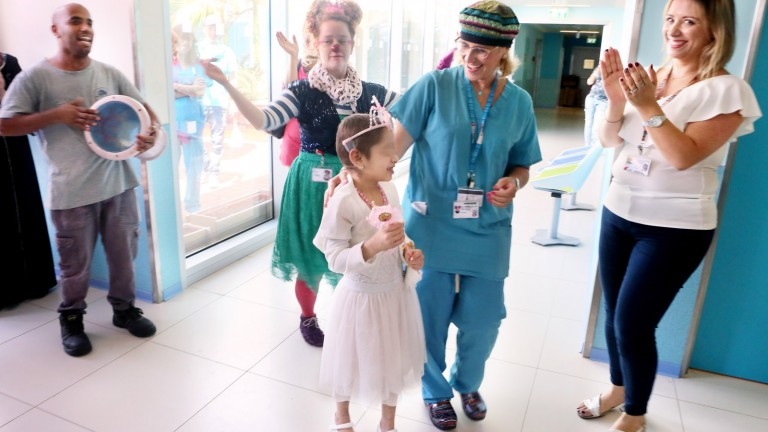 A Syrian girl says goodbye to her Israeli caregivers at Rambam Health Care Campus. Photo courtesy