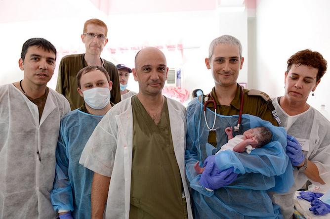 Baby Israel with the IDF team that delivered him at the IDF field hospital in Bogo City. Photo courtesy IDF