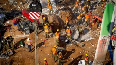 Rescue workers try to find survivors under the collapsed parking garage in Tel Aviv.  Photo by Miriam Alster FLASH90