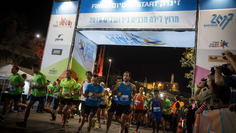 Runners take part in  Jerusalem Maccabiah Night Run on September 19, 2016. Photo by Hadas Parush/Flash90