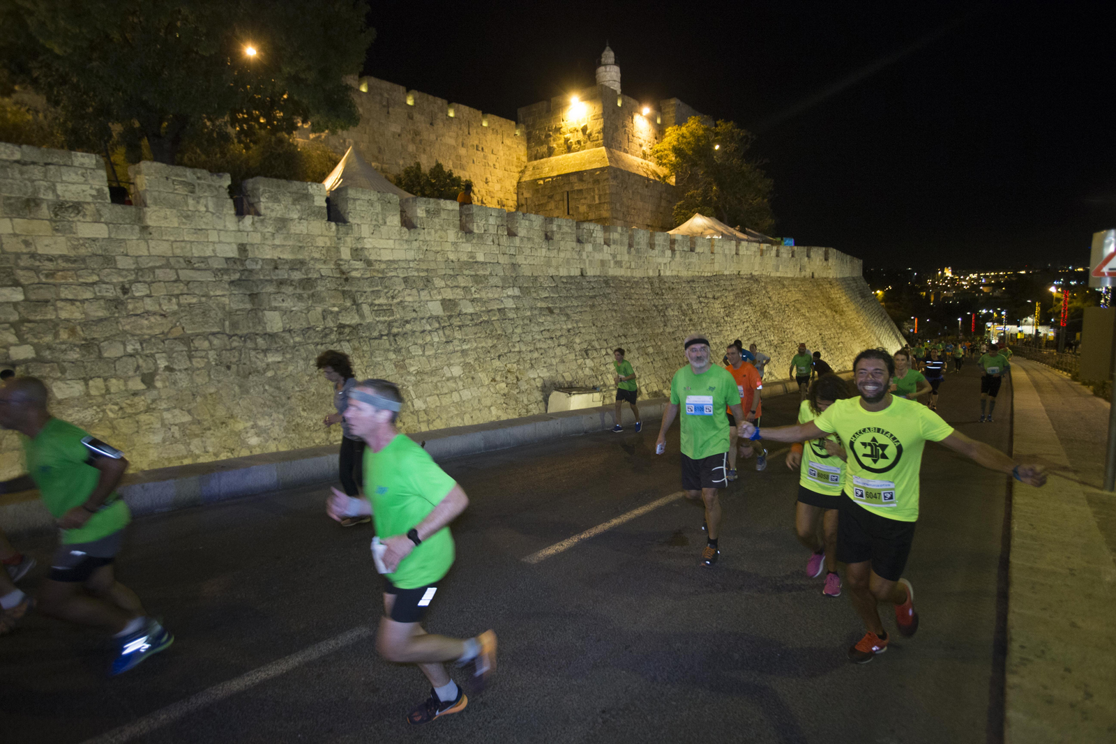 Running past landmarks in Jerusalem Maccabiah Night Run. Photo by Hadas Parush/Flash90