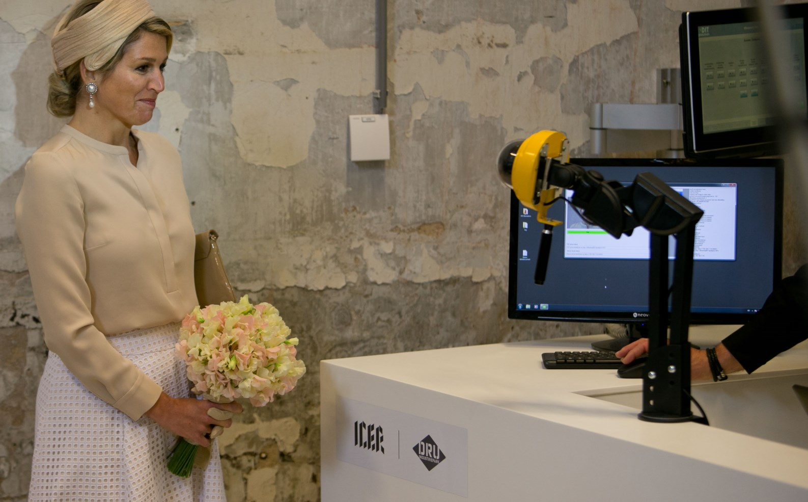 Queen Máxima of the Netherlands at a facial recognition station in the ICER Innovation Center in Holland, which employs FST's In Motion Identification technology to give visitors personalized information about exhibits as they pass through interactive checkpoints. Photo courtesy of ICER.EU