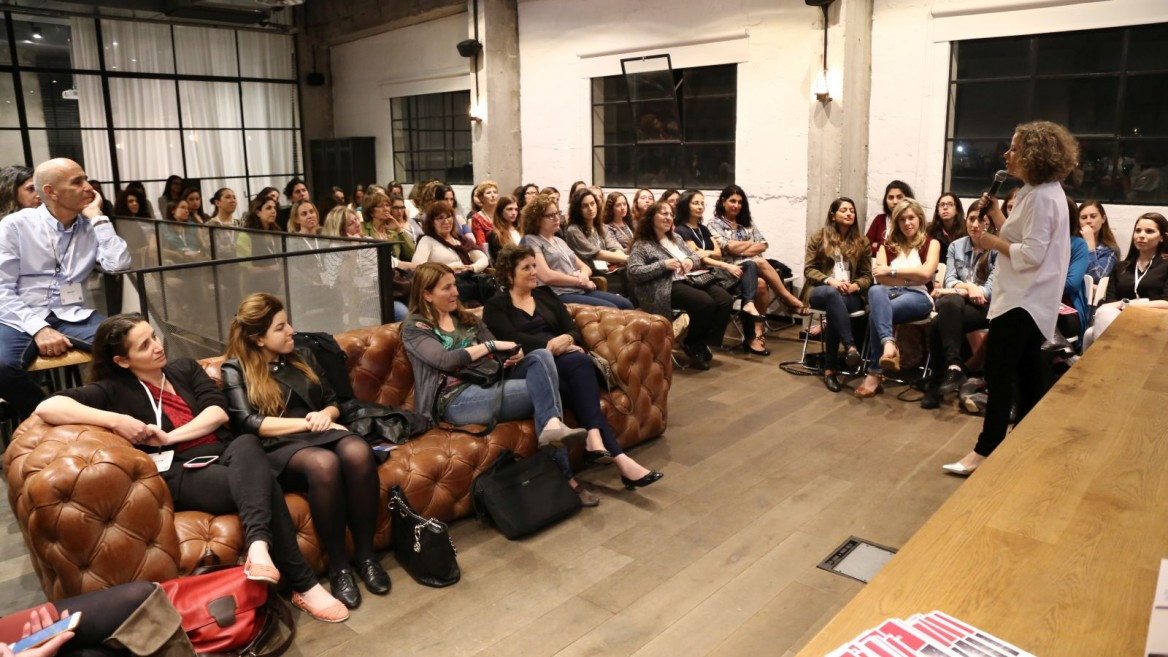 Woman2Woman participants getting words of wisdom from mentors. Photo: courtesy