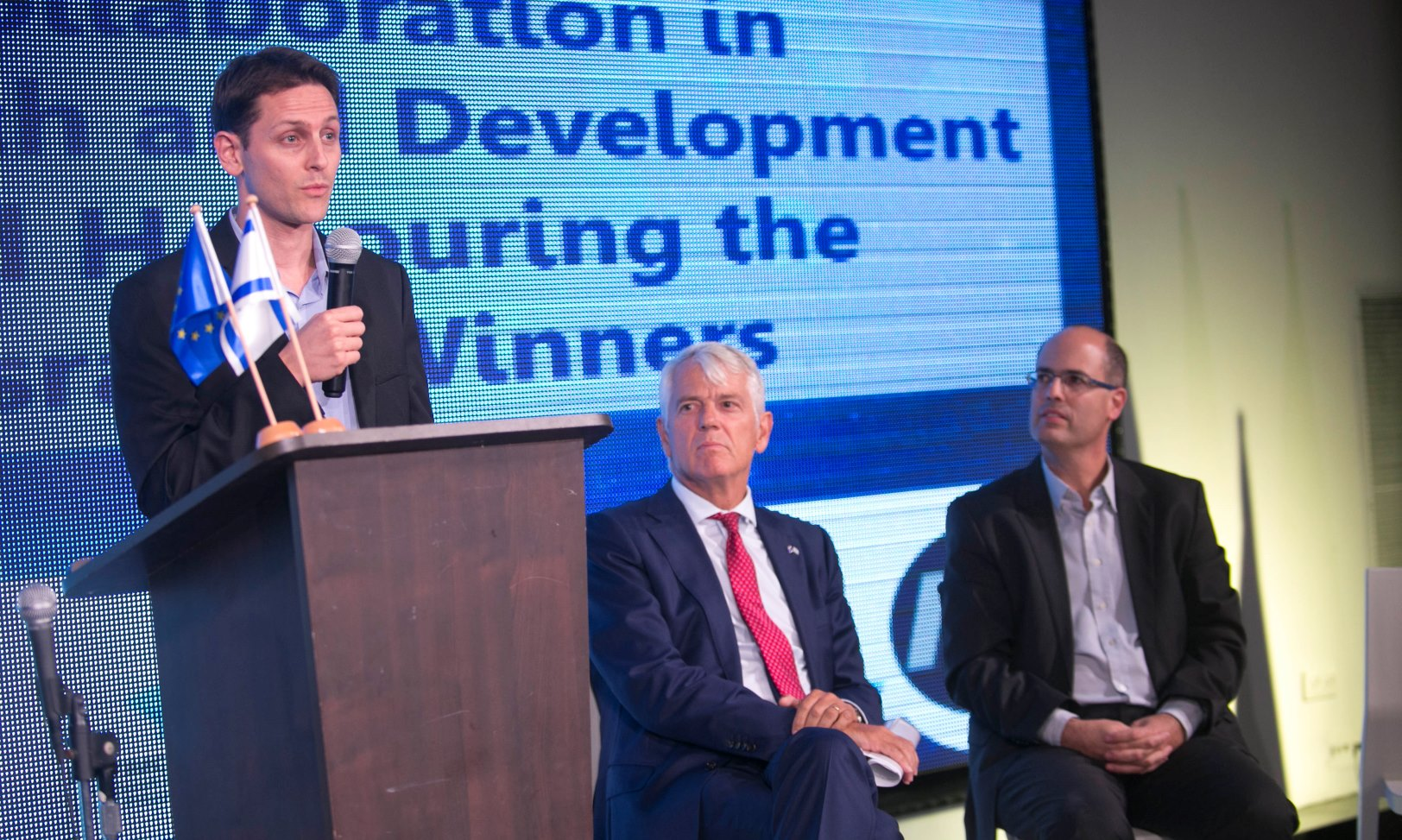 MeMed CEO Eran Eden speaking at the SME Instrument grant program finals in 2015. Next to him are Israeli Chief Scientist Avi Hasson, right, and Lars Faaborg-Andersen, EU ambassador to Israel. Photo courtesy of ISERD PR