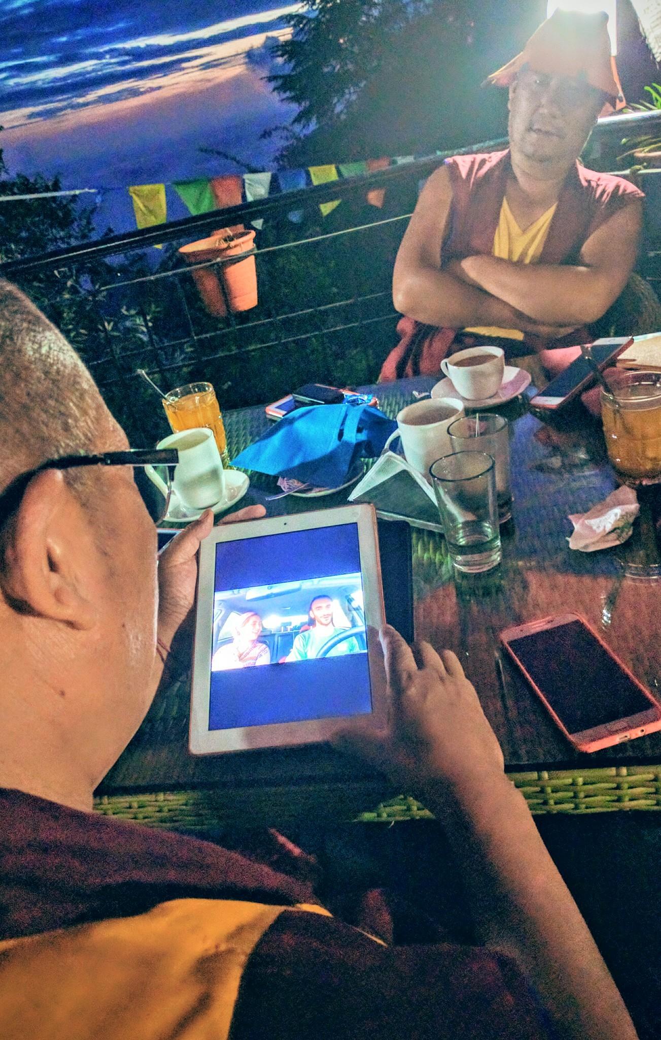 Tibetan monks enjoying a Yonina music video. Photo via Facebook