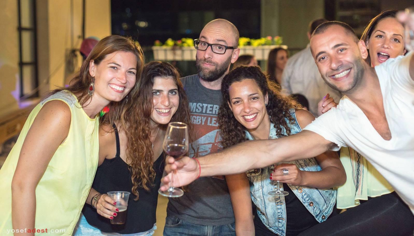 Wine Wednesday participants enjoying vino in Tel Aviv. Photo by Yosef Adest