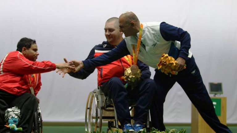 Bronze medalist Doron Shaziri of Israel extending a hand to silver medalist Abdullah Sultan al-Aryani of the United Arab Emirates. Photo by Keren Isaacson/Israel Paralympic Committee