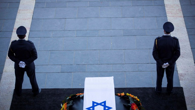 The Knesset Honor Guard stand by the coffin of Former Israeli President Shimon Peres ahead of the ceremony held at the Knesset where the public were invited to pay their last respects before his burial, in Jerusalem, on Thursday.