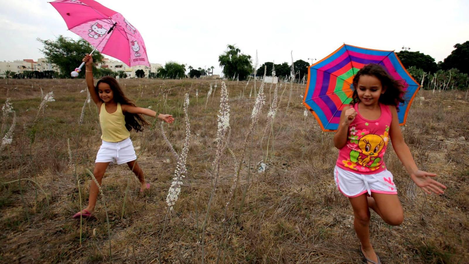 Children in Ashkelon celebrating the first rain of the season. Photo by Edi Israel/FLASH90