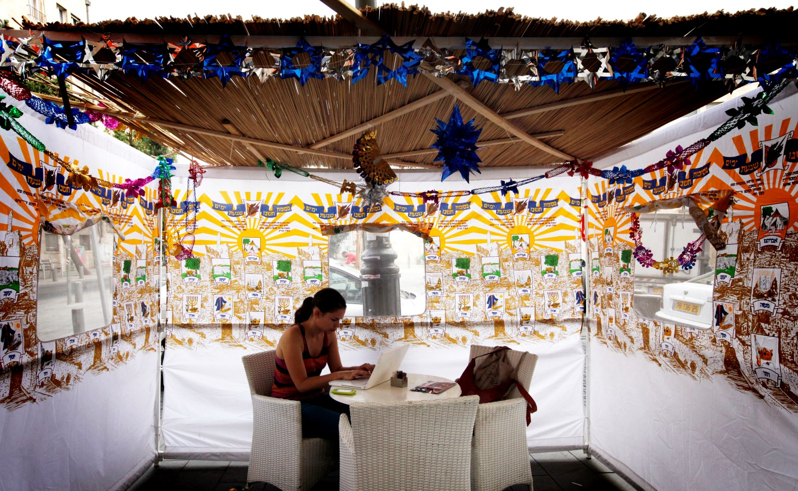 Trying to get some work done during Sukkot in Israel. Photo by Miriam Alster/FLASH90