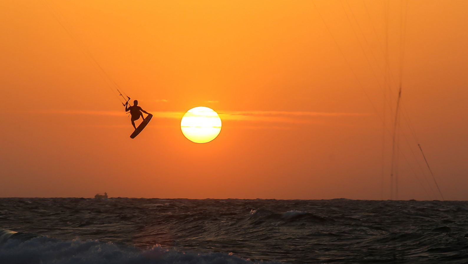 Kite surfers take to the waves at sunset at the Yamia beach in the Israeli city of Ashkelon, November 2, 2015. Photo by Edi Israel/FLASH90