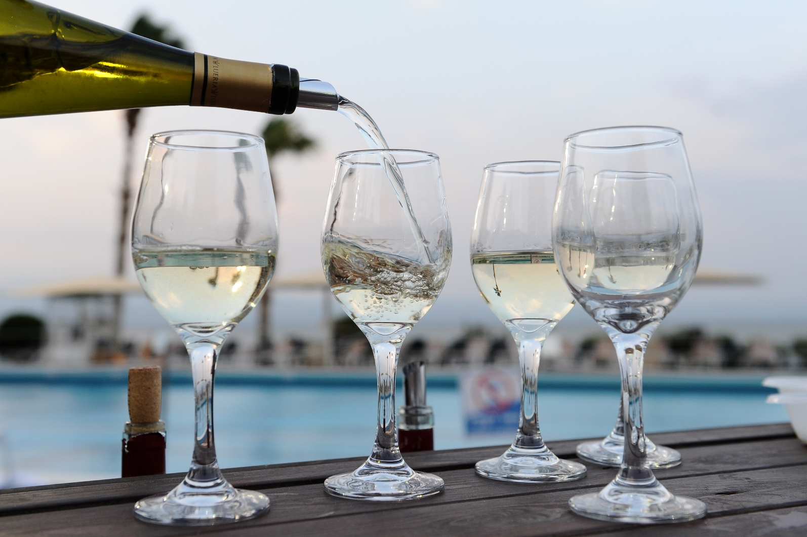White wines being poured in the northern Israeli city of Tiberias. Photo by Mendy Hechtman/FLASH90