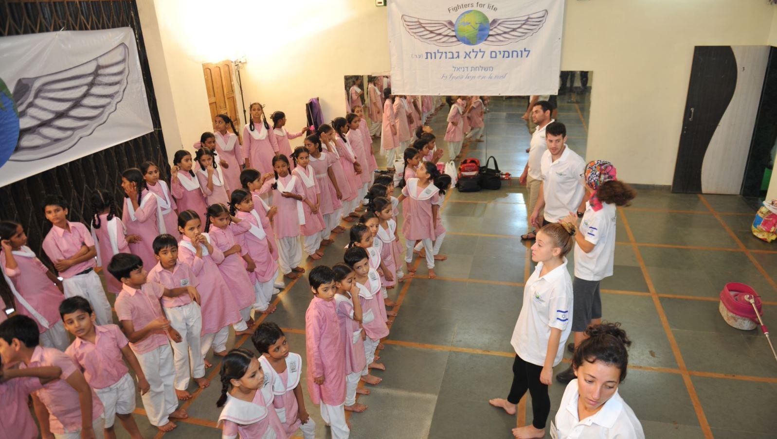 Israeli volunteers teaching children, many of them Muslim, in Mumbai. Photo courtesy of FFL