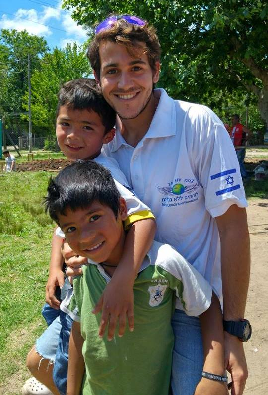 Omri Shamir volunteering with children in Buenos Aires. Photo courtesy of FFL