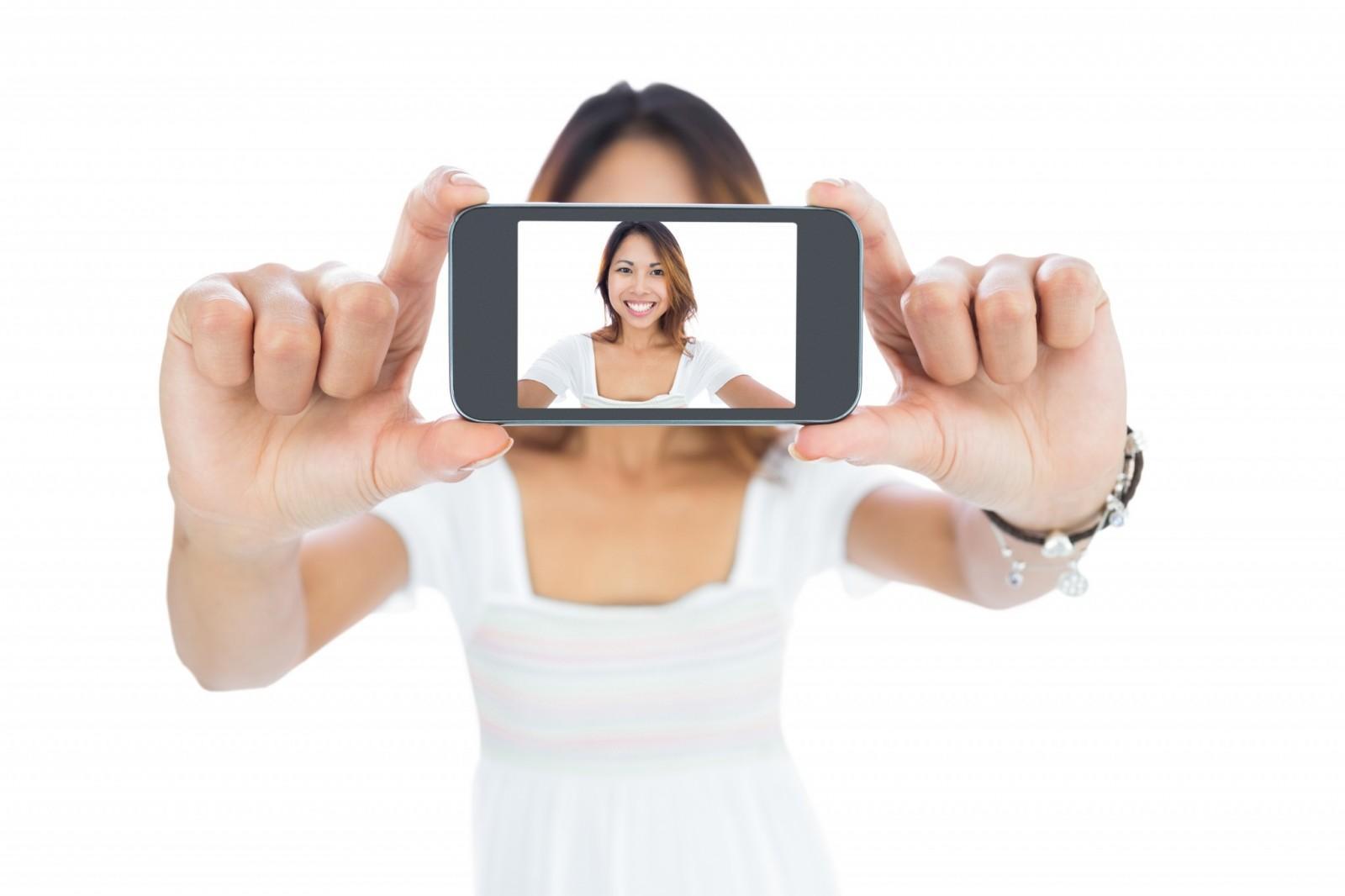 Selfie image via Shutterstock.com
