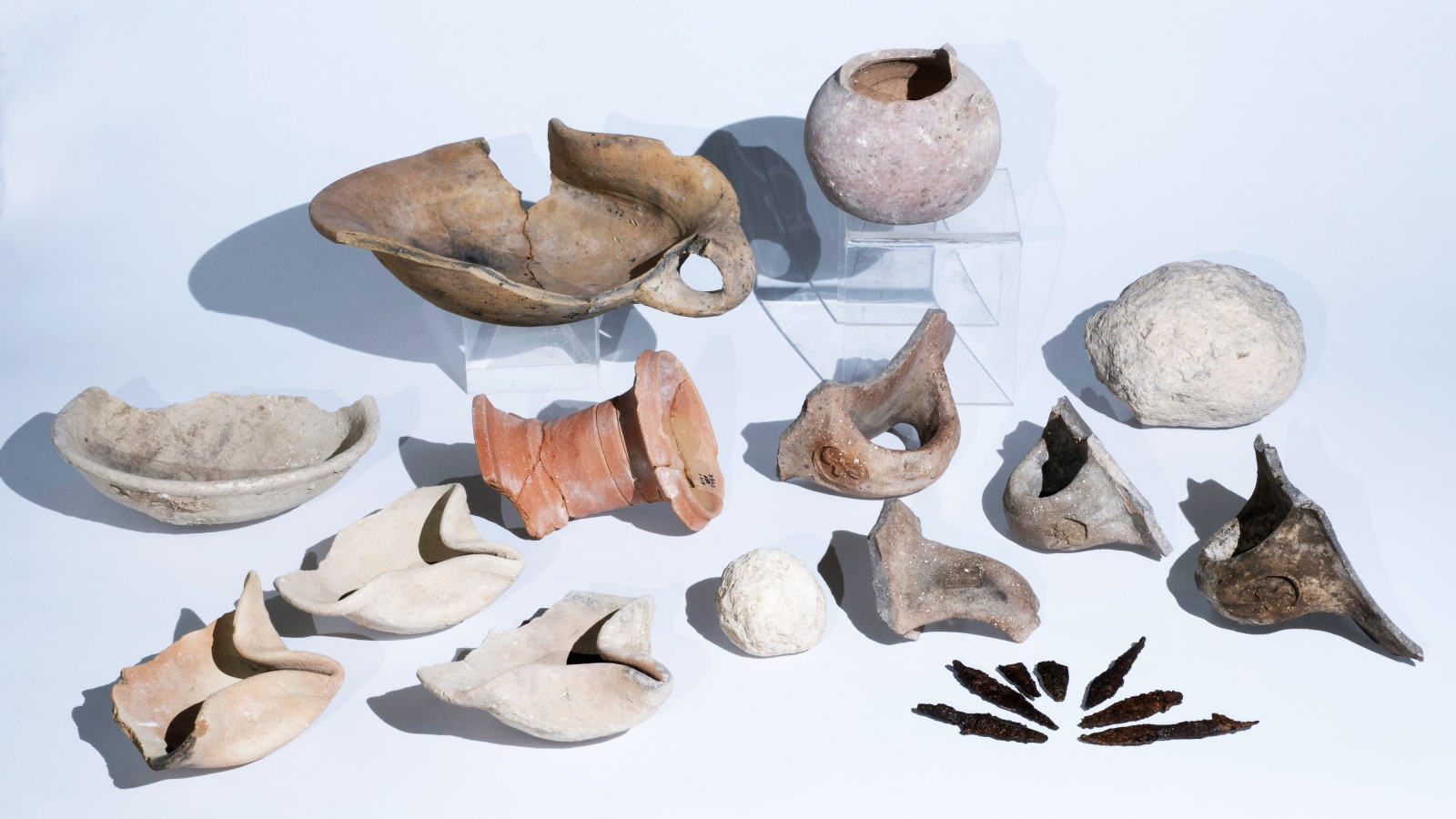 Artifacts from the First Temple period uncovered in Tel Lachish include oil lamps, arrowheads and seal impressions for identifying jars. Photo by Clara Amit/Israel Antiquities Authority