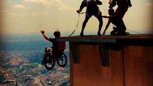 Lonnie Bissonnette uses a wheelchair fitted with SoftWheels to perform BASE jumps around the world. Photos via facebook.com/TheLonnieBissonnette