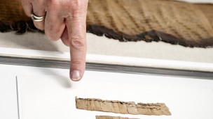 The document is preserved in the Israel Antiquities Authority's Dead Sea Scrolls laboratories. Photo: Shai Halevi, courtesy of the Israel Antiquities Authority.