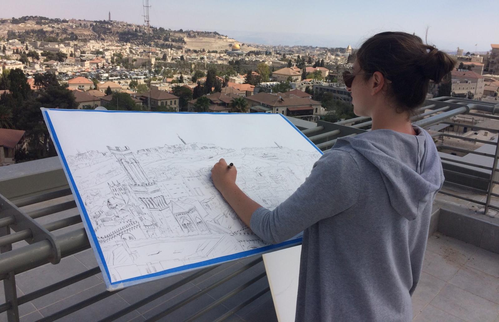 Lenore Cohen took up a position on the roof of Boutique Hanevi'im to draw her version of the skyline. Photo courtesy of Jerusalem Biennale