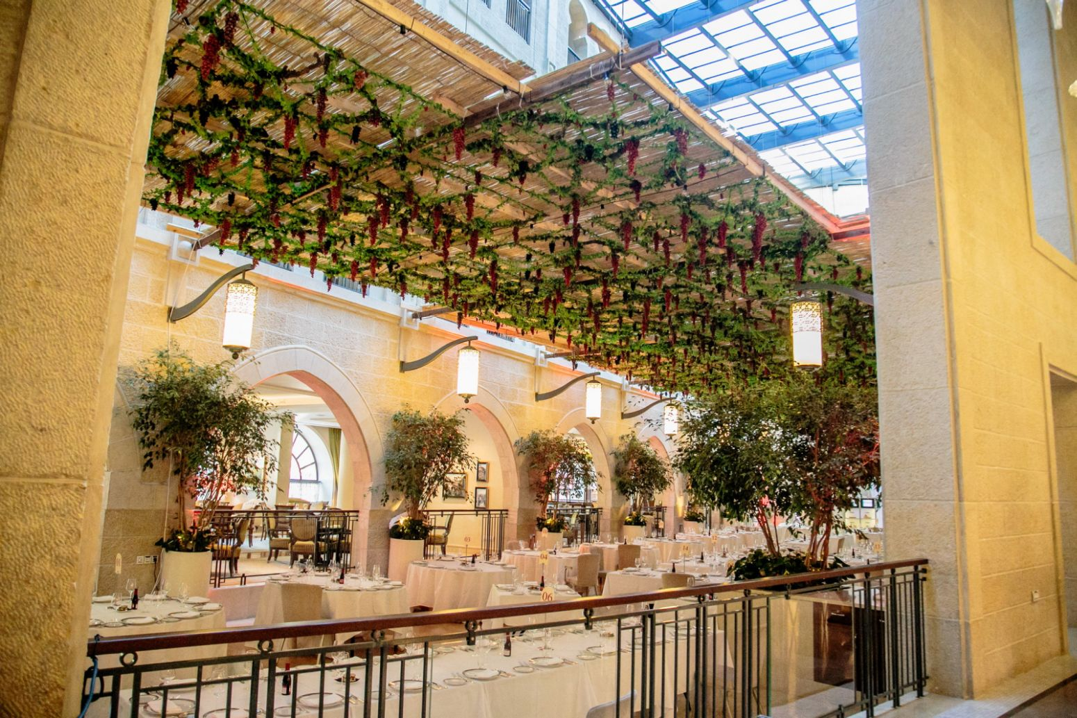 A side view of the atrium sukkah at the Waldorf Astoria Jerusalem. Photo by Perry Easy
