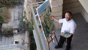 Motta Brim painting the Jerusalem skyline. Photo by Sofya Balashev