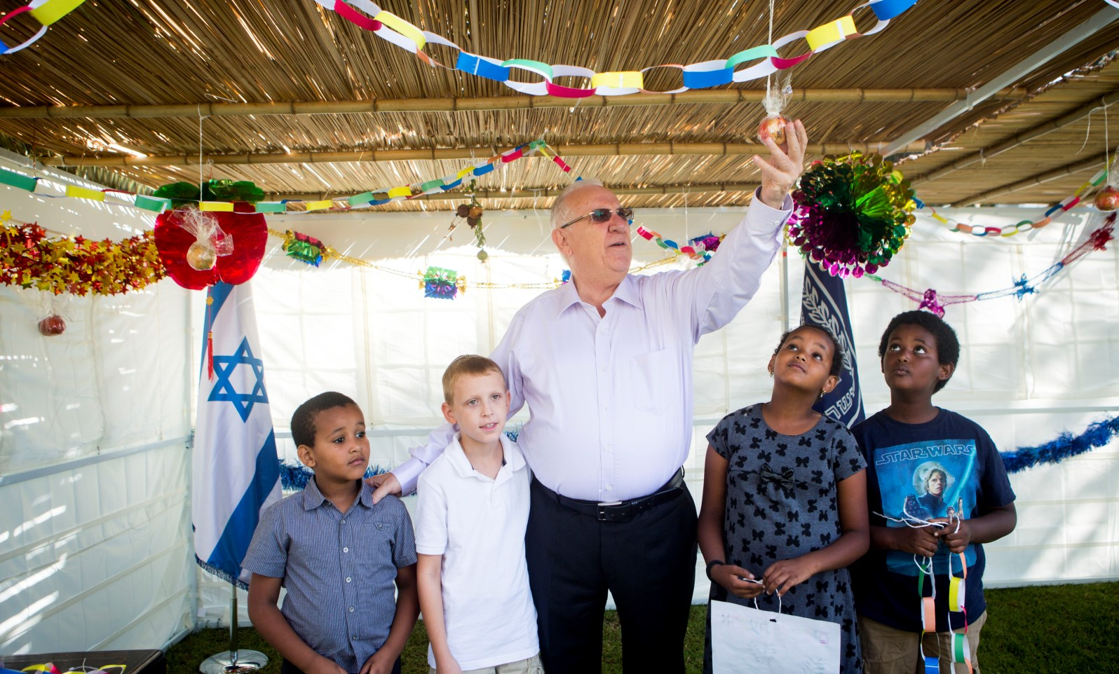 Every year, children are invited to help the Israeli president decorate the official sukkah in Jerusalem. Photo by Miriam Alster/FLASH90