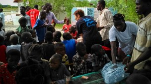 An IsraAID worker handing out necessities to Haitian children on October 7. Photo: courtesy
