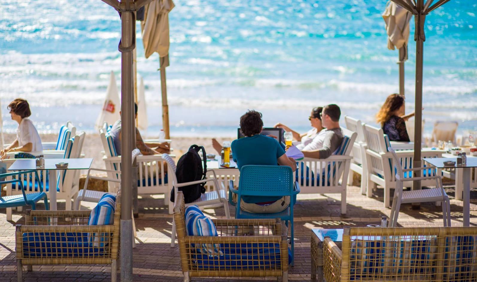Diners at Nika Beach restaurant, Herzliya Pituah. Photo via Facebook