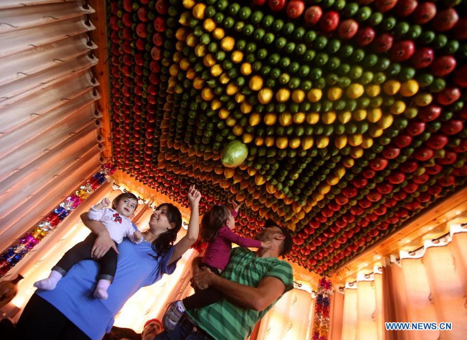 A Samaritan family celebrating Sukkot. Photo by Xinhua/Ayman Nobani