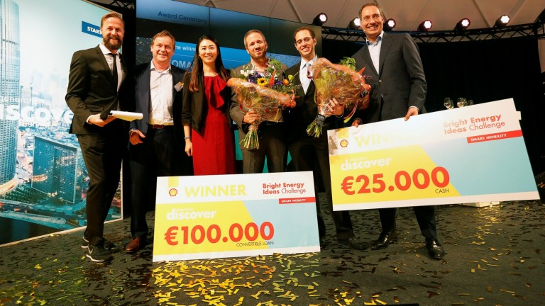 Geert van der Wouw, managing director of Shell Technology Ventures, second from left, with Shell and Neomatix executives at the awarding of first prize to Neomatix in the Shell Bright Energy Ideas Challenge in The Netherlands. Photo by Jiri Buller/AP images for Shell