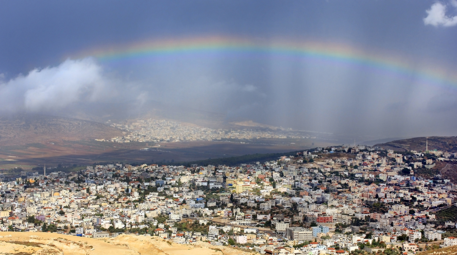 Rainbow over the Galilee village of Kafr Cana. Image via Shutterstock.com